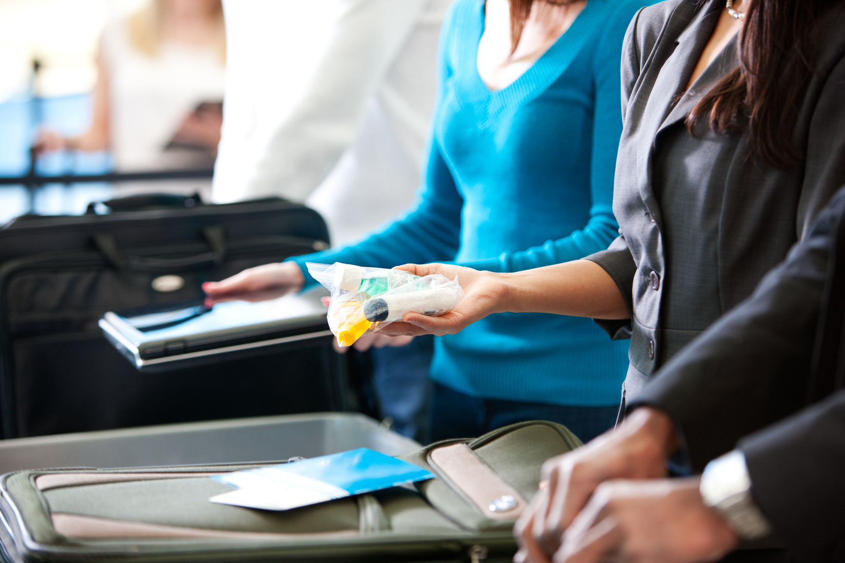Airport: Removing Plastic Bag of Toiletry Items