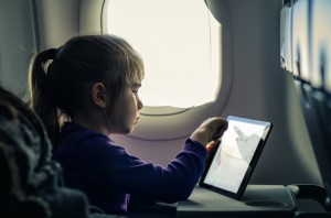 Girl Using Tablet On An Airplane