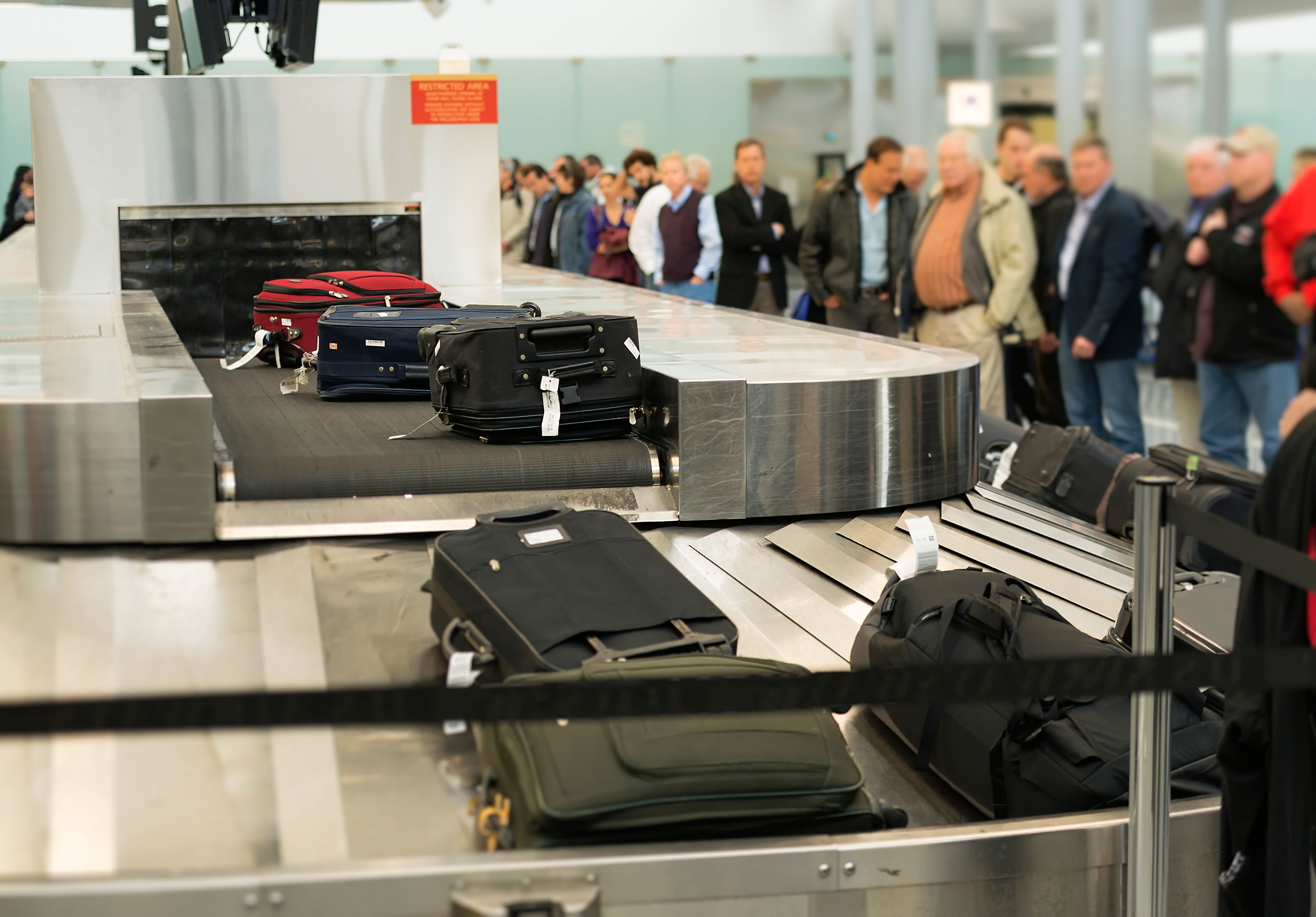 ' ' from the web at 'http://airlines.org/wp-content/uploads/2015/05/baggage-claim-Alamy.jpg'